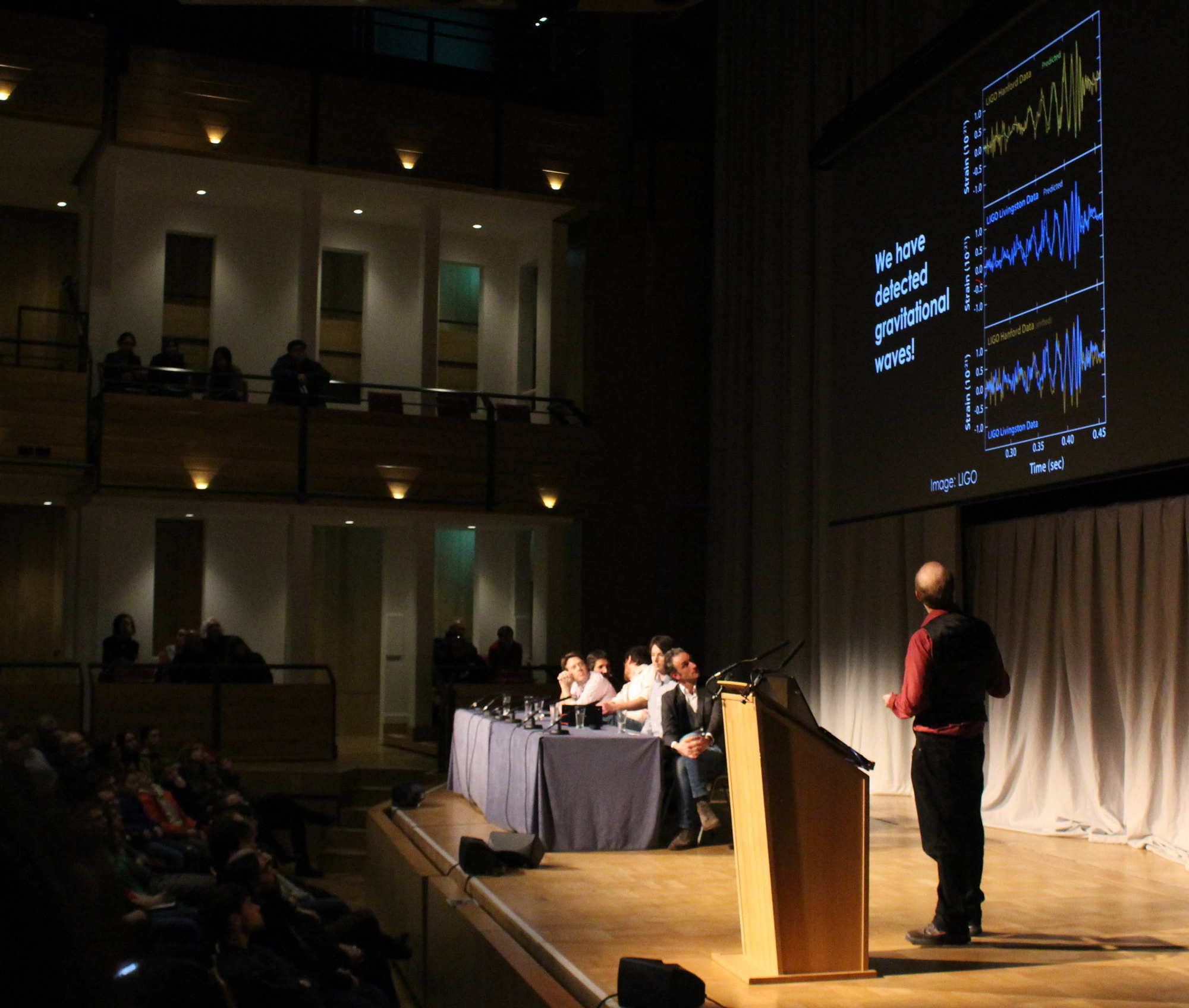 We have detected gravitational waves! Christopher Berry presenting the results in the Elgar Concert Hall, of the Bramall Music Building. Image credit: Hannah Middleton